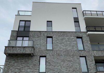 plaatsing inzetvliegenramen nieuwbouwproject Linkeroever Antwerpen